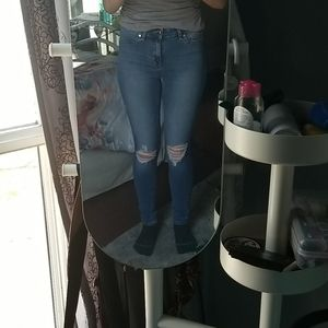 pre-distressed light wash jeans